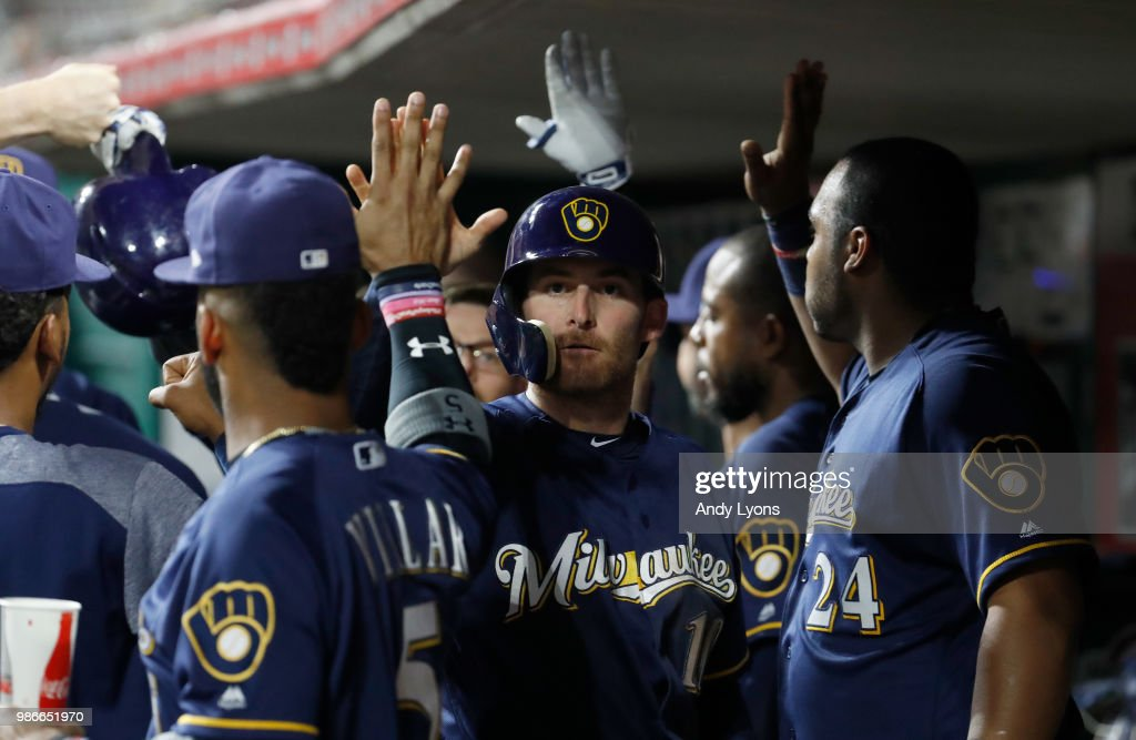 Brad Miller #10 of the Milwaukee Brewers celebrates after scoring in the 9th inning against the Cincinnati Reds at Great American Ball Park on June 28, 2018 in Cincinnati, Ohio.