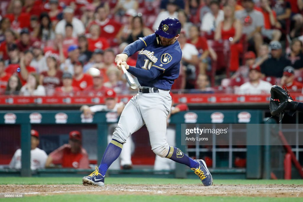 Brad Miller #10 of the Milwaukee Brewers hits a double in the 9th inning against the Cincinnati Reds at Great American Ball Park on June 28, 2018 in Cincinnati, Ohio.