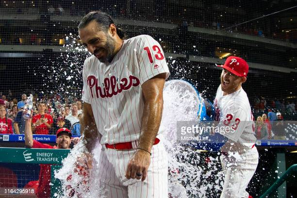 Brad Miller of the Philadelphia Phillies pours Powerade on Sean Rodriguez after Rodriguez hit a walk-off solo home run in the bottom of the 11th...
