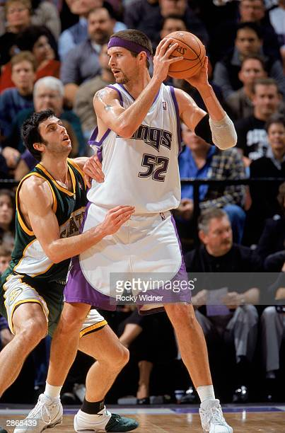 Brad Miller of the Sacramento Kings guards the ball against Vladimir Radmanovic of the Seattle Sonics during the NBA game at Arco Arena on January 4...