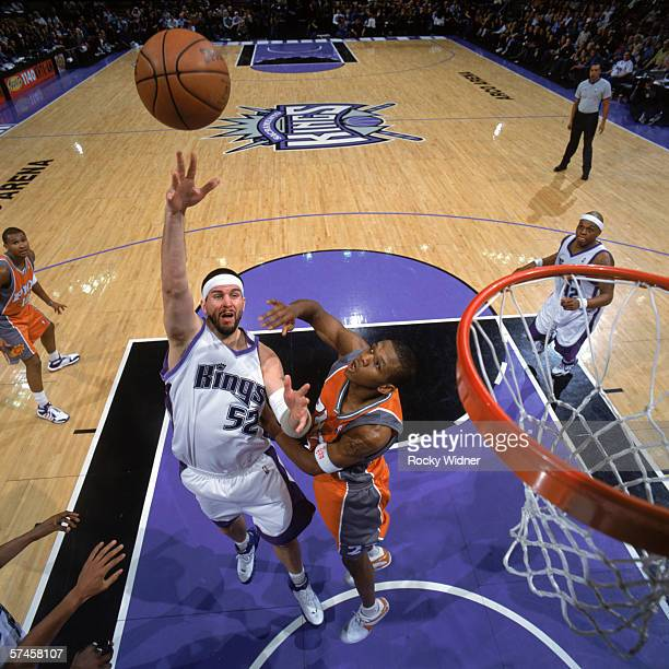Brad Miller of the Sacramento Kings puts up a shot against James Jones of the Phoenix Suns during a game at Arco Arena on April 4 2006 in Sacramento...