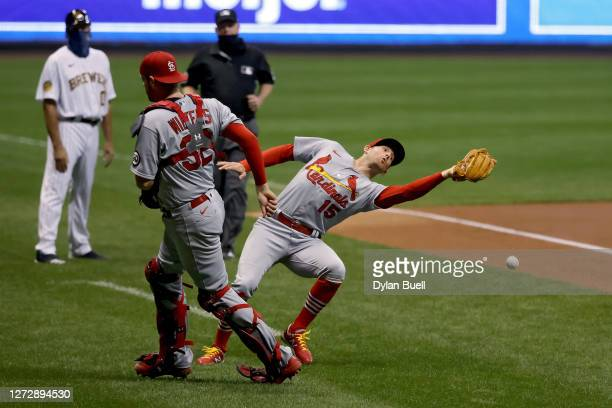 Brad Miller of the St. Louis Cardinals fails to catch a pop fly in the first inning against the Milwaukee Brewers during game two of a doubleheader...