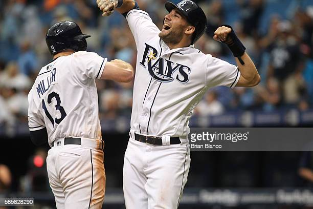 Brad Miller of the Tampa Bay Rays celebrates his threerun home run with teammate Kevin Kiermaier during the eighth inning of a game against the...