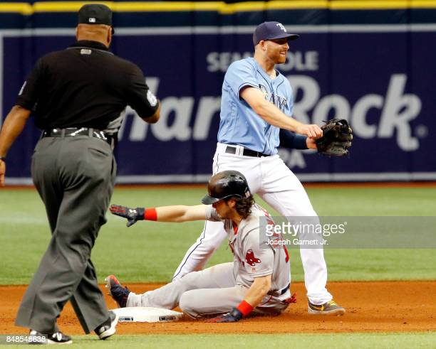 Brad Miller of the Tampa Bay Rays celebrates turning a double play at second base to end the game over Andrew Benintendi of the Boston Red Sox during...
