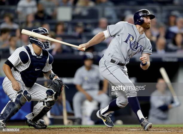 Brad Miller of the Tampa Bay Rays hits a two RBI double in the fifth inning as Gary Sanchez of the New York Yankees defends on July 27 2017 at Yankee...