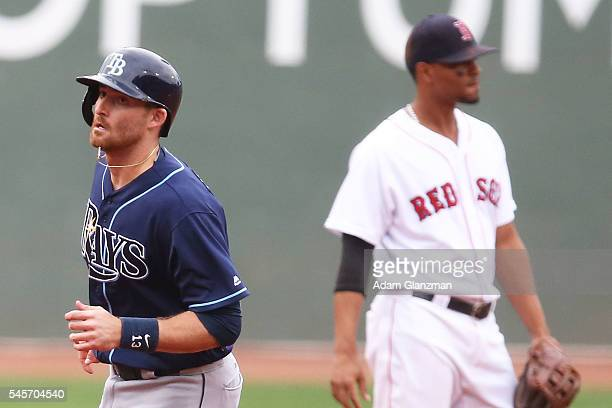 Brad Miller of the Tampa Bay Rays rounds the bases after hitting a solo home run in the first inning of against the Boston Red Sox at Fenway Park on...