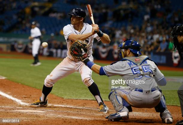 Brad Miller of the Tampa Bay Rays takes ball four from pitcher Casey Lawrence of the Toronto Blue Jays in front of catcher Russell Martin with the...