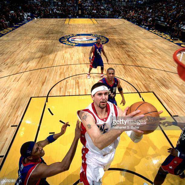 Brad Miller of the Western Conference AllStars shoots against Paul Pierce of the Eastern Conference AllStars during the 2004 AllStar Game on February...