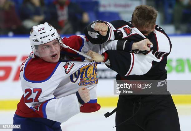 Brad Morrison of the Vancouver Giants fights Trey FixWolanski of the Edmonton Oil Kings during the third period of their WHL game at the Langley...