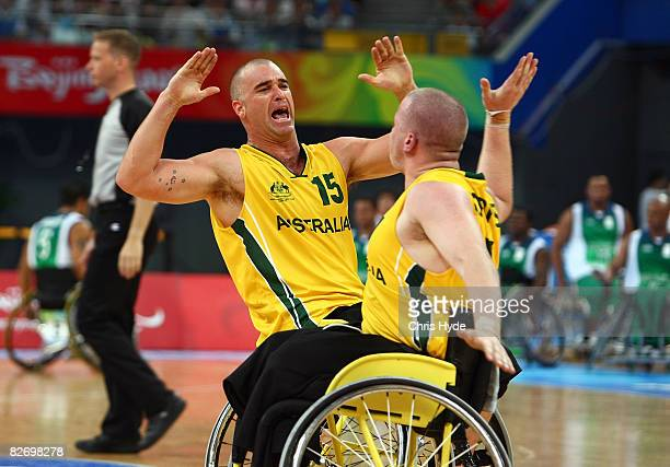 Brad Ness and Shaun Norris celebrate during the Wheelchair Basketball match between Australia and Brazil at the National Indoor Stadium on September...
