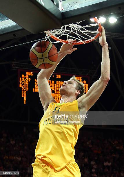 Brad Newley of Australia slam dunks the ball against Russia during the Men's Basketball Preliminary Round match on Day 10 of the London 2012 Olympic...
