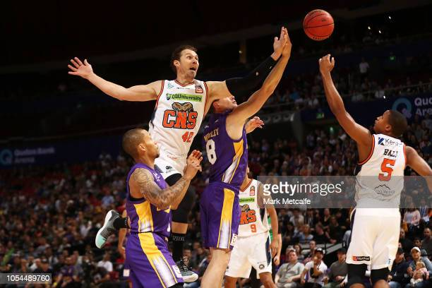 Brad Newley of the Kings and Alex Loughton of the Taipans compete for a rebound during the round three NBL match between the Sydney Kings and the...