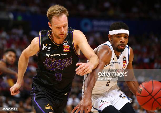 Brad Newley of the Kings and Perrin Buford of the Bullets contest possession during the round nine NBL match between the Sydney Kings and the...