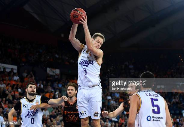 Brad Newley of the Kings collects a rebound during the round eight NBL match between the Cairns Taipans and the Sydney Kings at Cairns Convention...