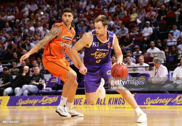 Brad Newley of the Kings controls the ball during the round eight NBL match between the Sydney Kings and the Cairns Taipans at Qudos Bank Arena on...