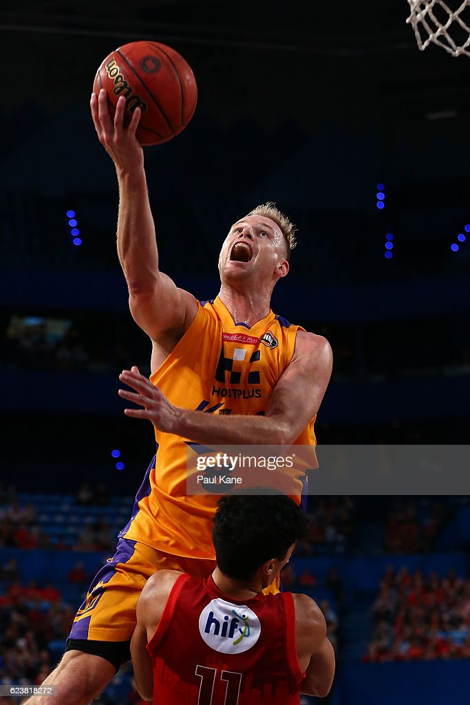 Brad Newley of the Kings drives to the basket against Mason Bragg of the Wildcats during the round seven NBL match between the Perth Wildcats and the Sydney Kings at Perth Arena on November 17, 2016 in Perth, Australia.