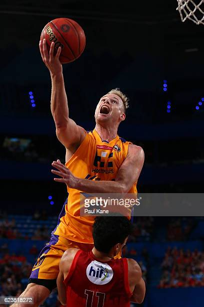 Brad Newley of the Kings drives to the basket against Mason Bragg of the Wildcats during the round seven NBL match between the Perth Wildcats and the...