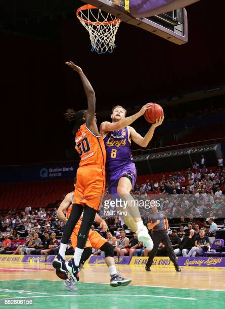 Brad Newley of the Kings drives to the basket during the round eight NBL match between the Sydney Kings and the Cairns Taipans at Qudos Bank Arena on...