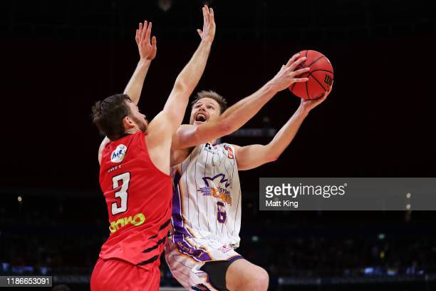 Brad Newley of the Kings drives to the basket under pressure from Nicholas Kay of the Wildcats during the round six NBL match between the Sydney...