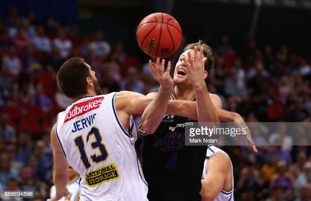 Brad Newley of the KIngs is fouled during the round nine NBL match between the Sydney Kings and the Brisbane Bullets at Qudos Bank Arena on December...
