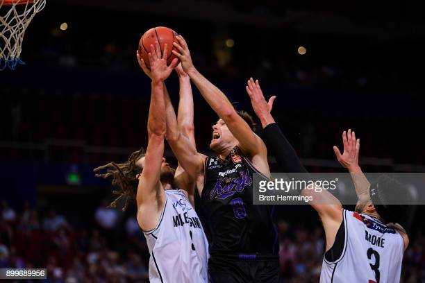 Brad Newley of the Kings lays up a shot under pressure during the round 12 NBL match between the Sydney Kings and Melbourne United at Qudos Bank...