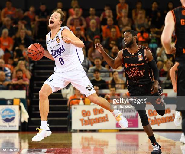 Brad Newley of the Kings reacts after making contact with Scoochie Smith of the Taipans during the round eight NBL match between the Cairns Taipans...