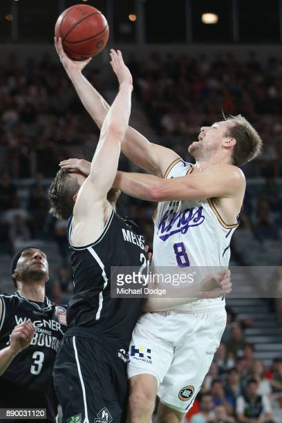 Brad Newley of the Kings shoots a basket over David Barlow of United during the round nine NBL match between Melbourne United and the Sydney Kings at...