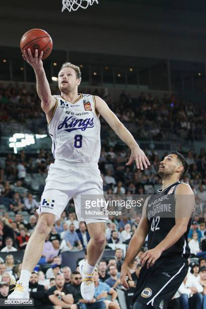 Brad Newley of the Kings shoots a basket over Tai Wesley of United during the round nine NBL match between Melbourne United and the Sydney Kings at...