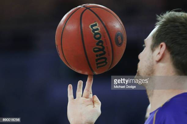 Brad Newley of the Kings spins the ball in the warm up during the round nine NBL match between Melbourne United and the Sydney Kings at Hisense Arena...