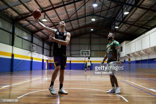 Brad Newley of the Kings talks to Adam Reynolds of the Rabbitohs during a joint media opportunity with the Sydney Kings and South Sydney Rabbitohs at...
