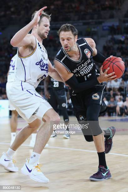 Brad Newley of the Kings tries to defend David Anderson of United during the round nine NBL match between Melbourne United and the Sydney Kings at...