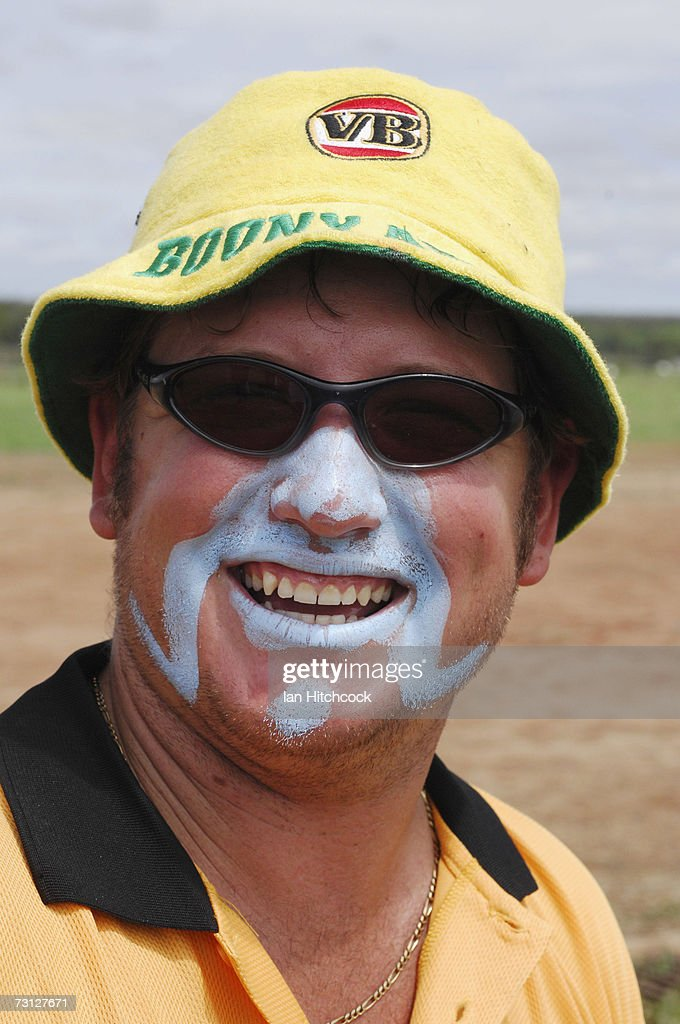 Brad Nicholason of the team 'Coral Coast Marine Madmans' shares a joke with teammates during the Goldfield Ashes January 27, 2007 in Charters Towers, Australia. Every Australia Day weekend the small outback town of Charters Towers in North Queensland hosts a cricket carnival named 'The Goldfield Ashes'. In 1949 the Charters Towers Cricket Association extended an invitation to six town to play on Foundation Day. From those six teams the carnival has grown to a record 194 teams competing in 2007, making it the largest carnival of its type in the world. The Goldfield Ashes swells the 8000 strong population of Charters Towers, near Townsville, by about 3000 and attracts teams of solicitors, engineers and television crews from as far as Brisbane. Matches are played on 58 different playing fields, including some which are privately owned. It is one of the few sporting carnivals which caters for players of all levels of ability