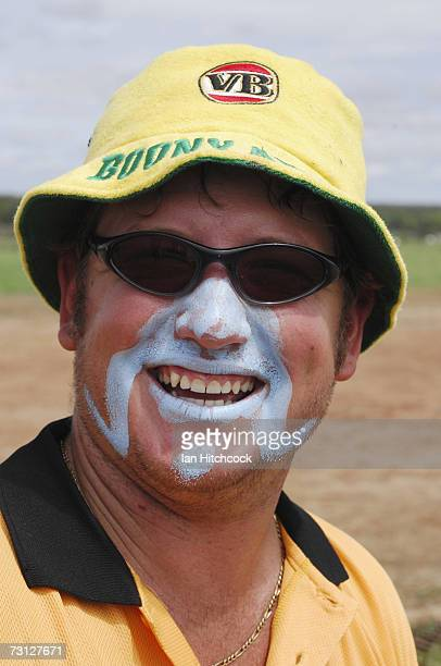 Brad Nicholason of the team 'Coral Coast Marine Madmans' shares a joke with teammates during the Goldfield Ashes January 27 2007 in Charters Towers...