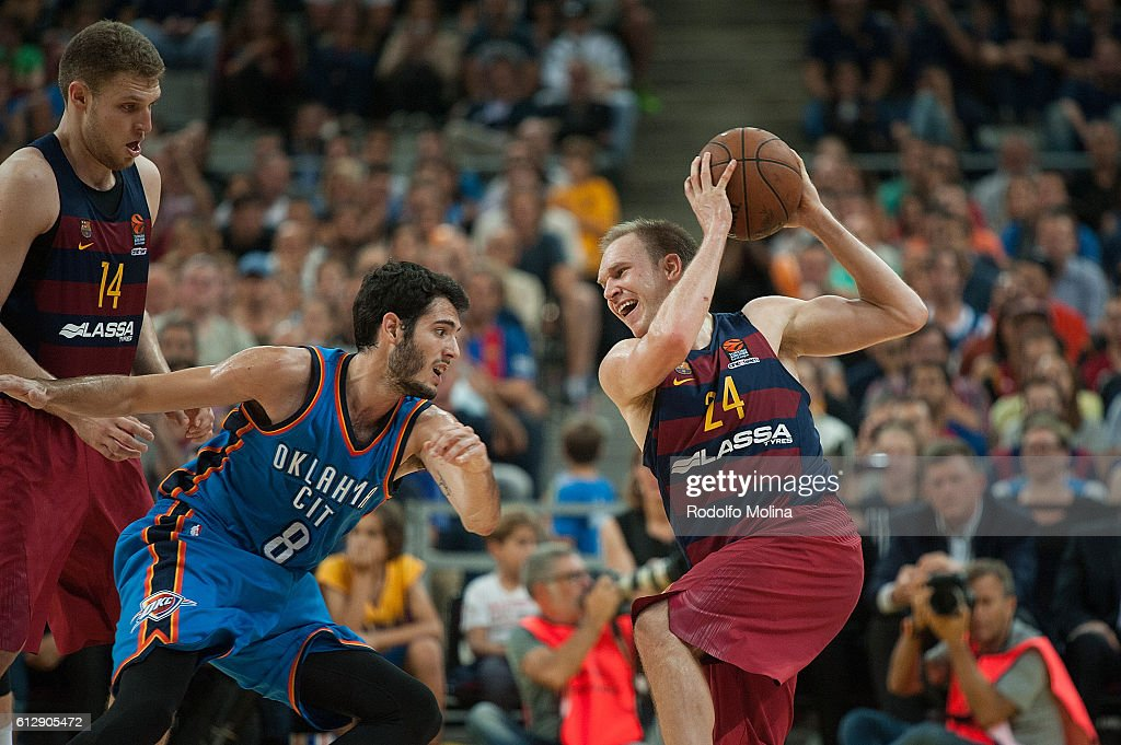 Brad Oleson, #24 of FC Barcelona Lassa competes with Alex Abrines, #8 of Oklahoma City Thunder during the NBA Global Games Spain 2016 FC Barcelona Lassa v Oklahoma City Thunder at Palau Sant Jordi on October 5, 2016 in Barcelona, Spain.