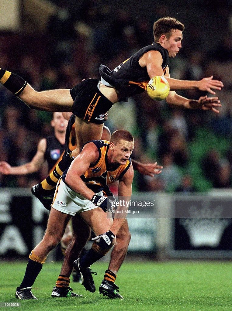 Brad Ottens of Richmond takes flying mark over Guy McKenna of West Coast, in the match between Richmond and the West Coast Eagles, during round five of the AFL season, played at the Melbourne Cricket Ground, Melbourne, Australia. Mandatory Credit:Stuart Milligan/ALLSPORT
