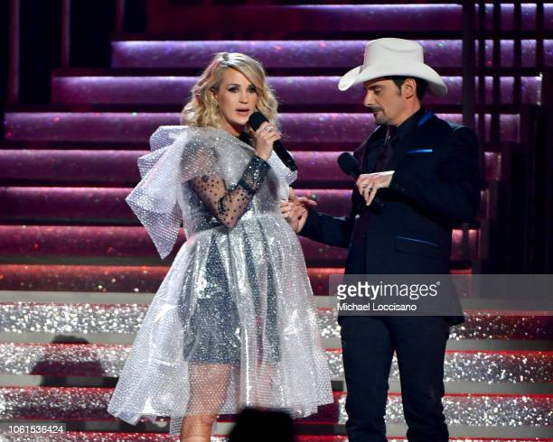 Brad Paisley and Carrie Underwood speak onstage during the 52nd annual CMA Awards at the Bridgestone Arena on November 14 2018 in Nashville Tennessee