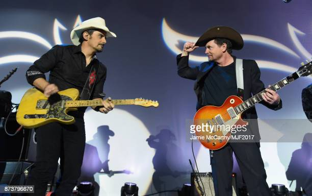 Brad Paisley and Michael J Fox perform on stage at A Funny Thing Happened On The Way To Cure Parkinson's benefitting The Michael J Fox Foundation at...