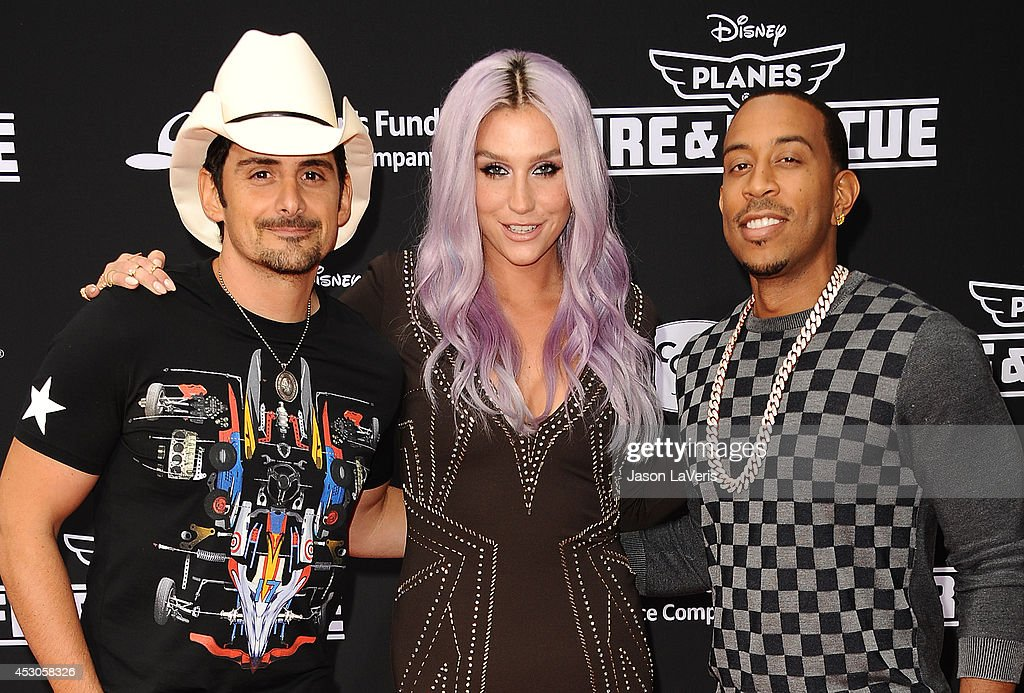 Brad Paisley, Kesha and Chris 'Ludacris' Bridges attend the premiere of 'Planes: Fire & Rescue' at the El Capitan Theatre on July 15, 2014 in Hollywood, California.