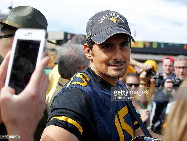 Brad Paisley looks on from the sideline before the game between the West Virginia Mountaineers and the Maryland Terrapins on September 26 2015 at...