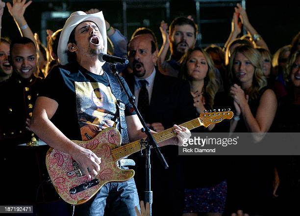 Brad Paisley performs onstage during the 47th annual CMA Awards at the Bridgestone Arena on November 6 2013 in Nashville Tennessee