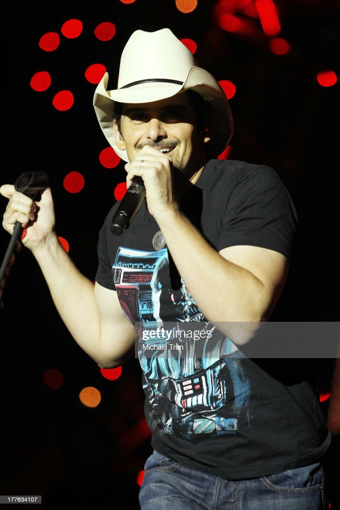 Brad Paisley performs onstage during the 'Beat This Summer Tour' held at San Manuel Amphitheater on August 24, 2013 in San Bernardino, California.