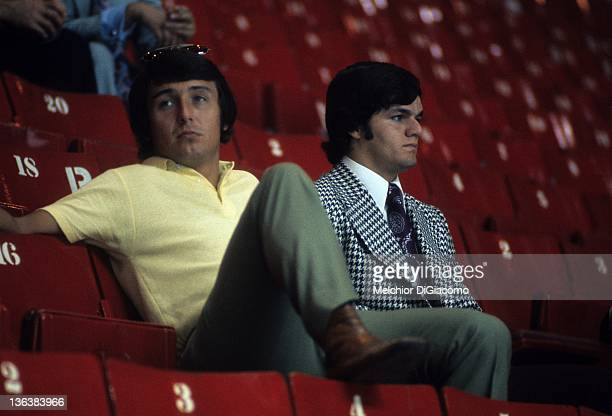 Brad Park and Marcel Dionne of Canada sit in the stands during the Soviets practice before Game 1 of the 1972 Summit Series on September 1, 1972 at...