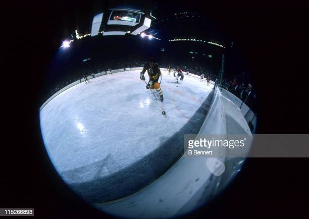 Brad Park of the Boston Bruins skates with the puck along the boards during an NHL game against the Washington Capitals on December 27 1977 at the...
