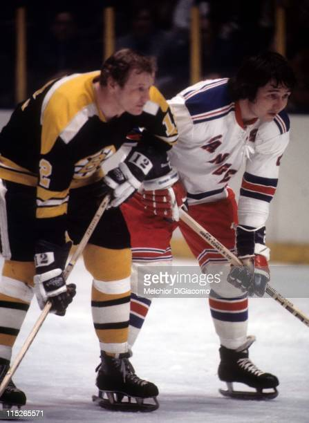 Brad Park of the New York Rangers and Wayne Cashman of the Boston Bruins wait for the faceoff during their game circa 1973 at the Madison Square...