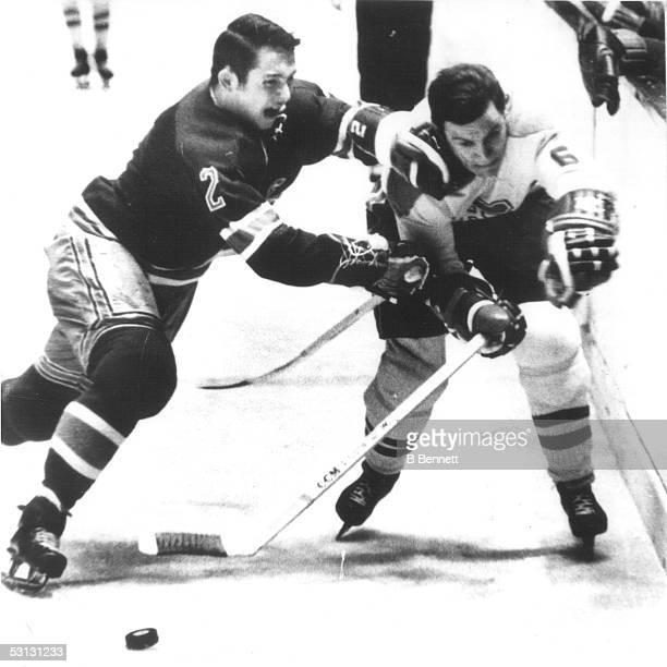 Brad Park of the New York Rangers battles with Ralph Backstrom of the Montreal Canadiens on January 26 1969 at the Madison Square Garden in New York...