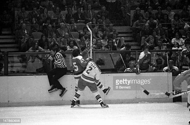 Brad Park of the New York Rangers checks Jim Hrycuik of the Washington Capitals on October 9 1974 at the Madison Square Garden in New York New York