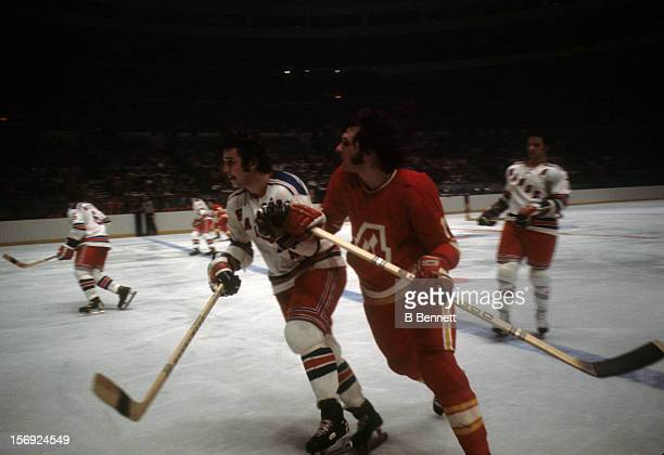 Brad Park of the New York Rangers defends against Butch Deadmarsh of the Atlanta Flames circa 1972 at the Madison Square Garden in New York New York