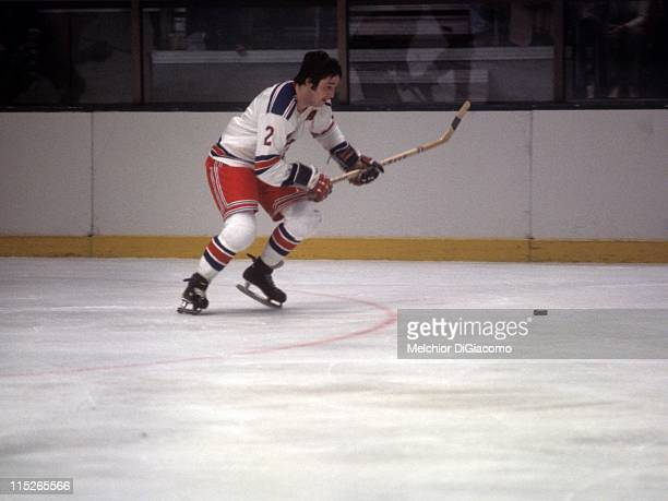 Brad Park of the New York Rangers skates with the puck during an NHL game against the Montreal Canadiens circa 1974 at the Madison Square Garden in...