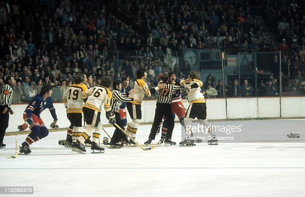 Brad Park of the New York Rangers tries to fight Terry O'Reilly of the Boston Bruins as Carol Vadnais Fred O'Donnell and Gregg Sheppard of the Bruins...