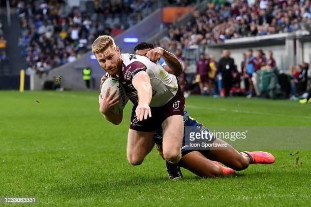 Brad Parker of the Sea Eagles breaks the tackle of Waqa Blake of the Eels and scores a try during the round eleven NRL match between the Parramatta...